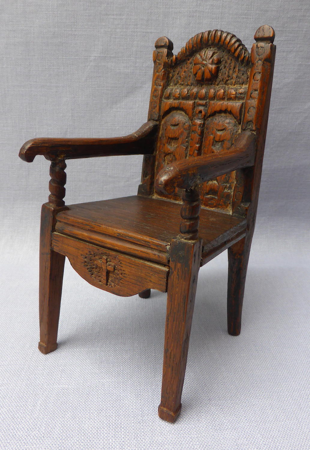 Late 19th century miniature carved wainscot chair