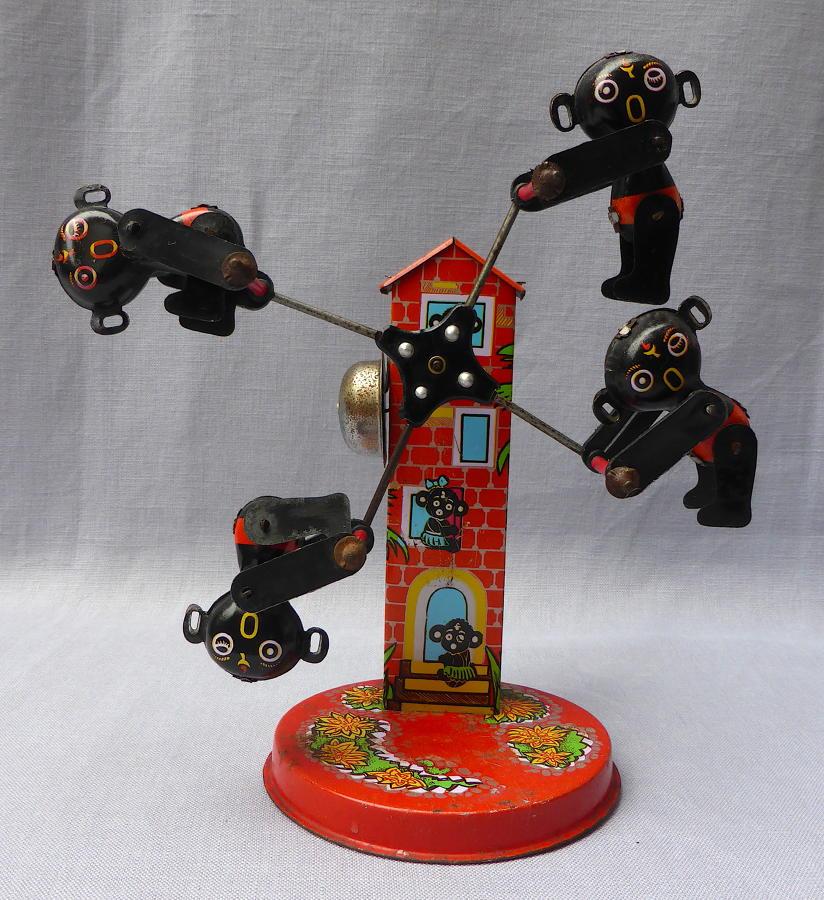 1960s Japanese Dakkochan wind-up tin plate toy