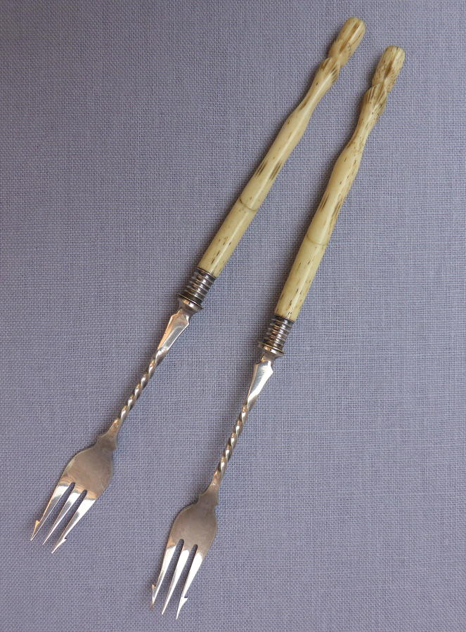 Pair of late 19th century hoof handle pickle forks