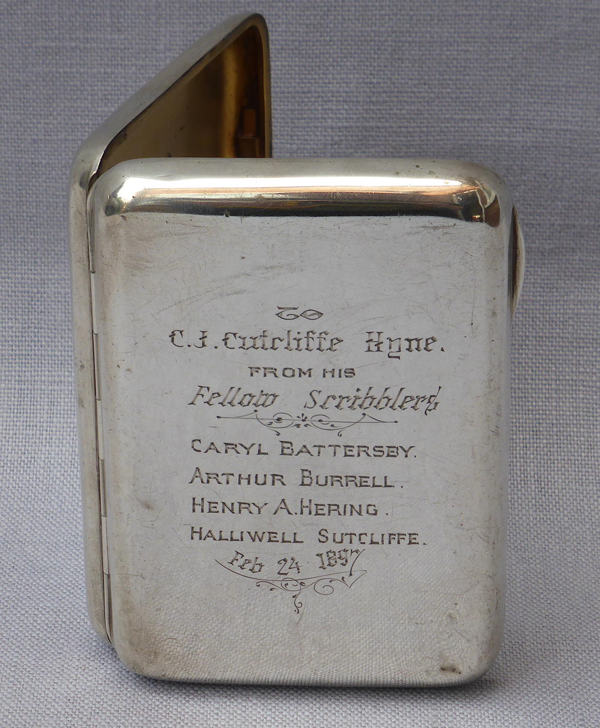 Silver cigarette case inscribed to C J Cutcliffe Hyne Chester 1895