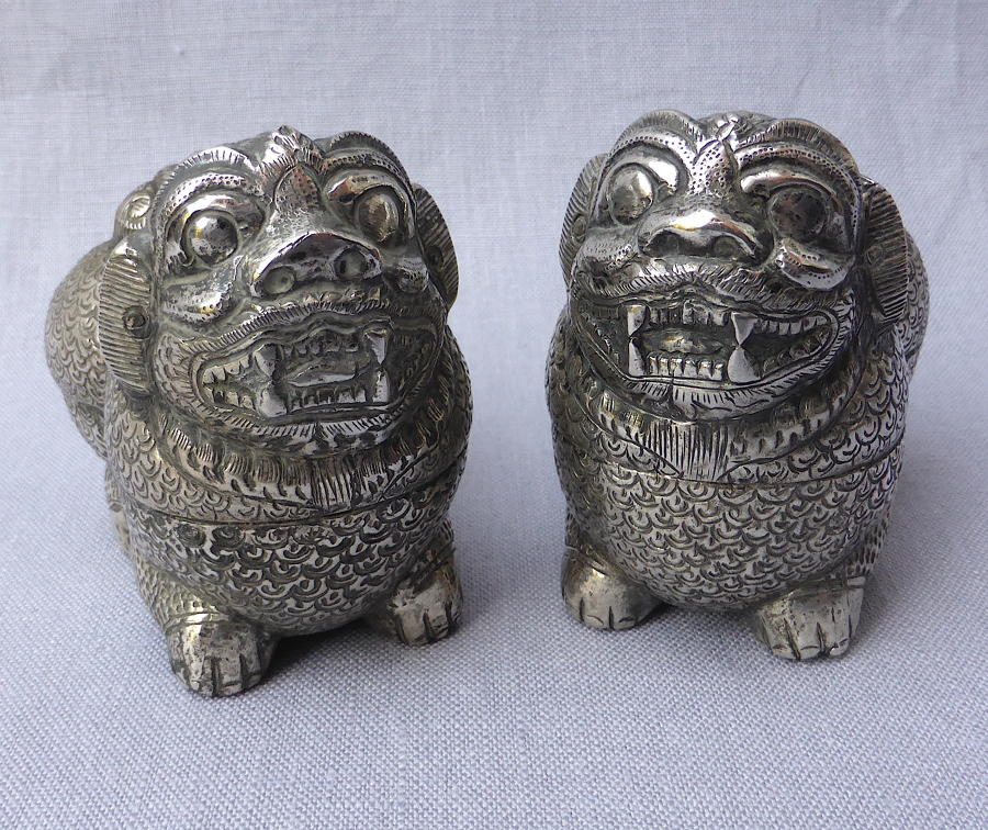 Pair of Cambodian silver Foo lion dog betel nut boxes