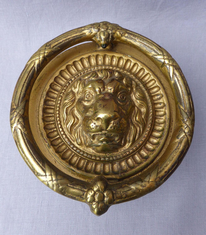 Fine early 20th century brass lion's head door knocker
