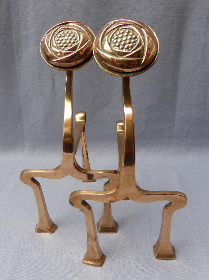 Fine pair of Arts & Crafts style copper fire dogs