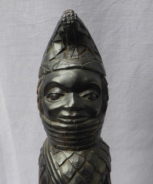Carved ebony tribal figure of the Benin Oba of Nigeria