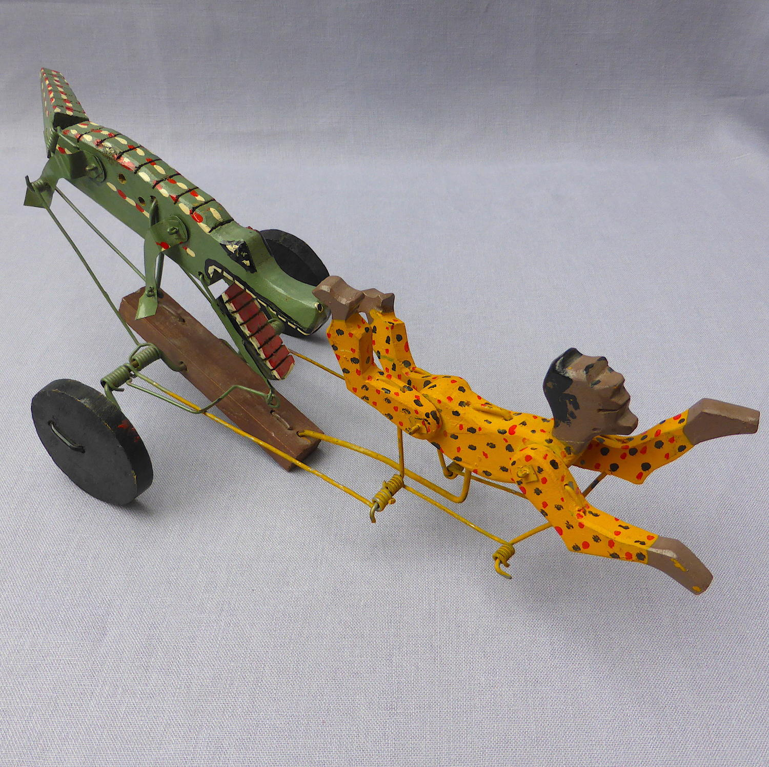 Folk art swimmer & crocodile automaton toy