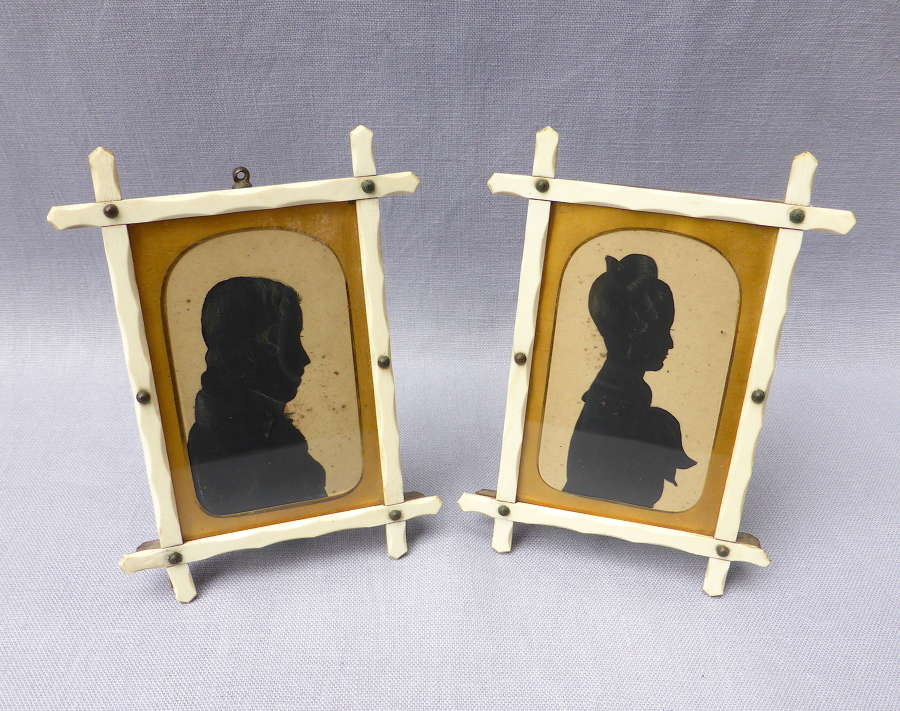 Pair of early 19thC miniature silhouette portraits