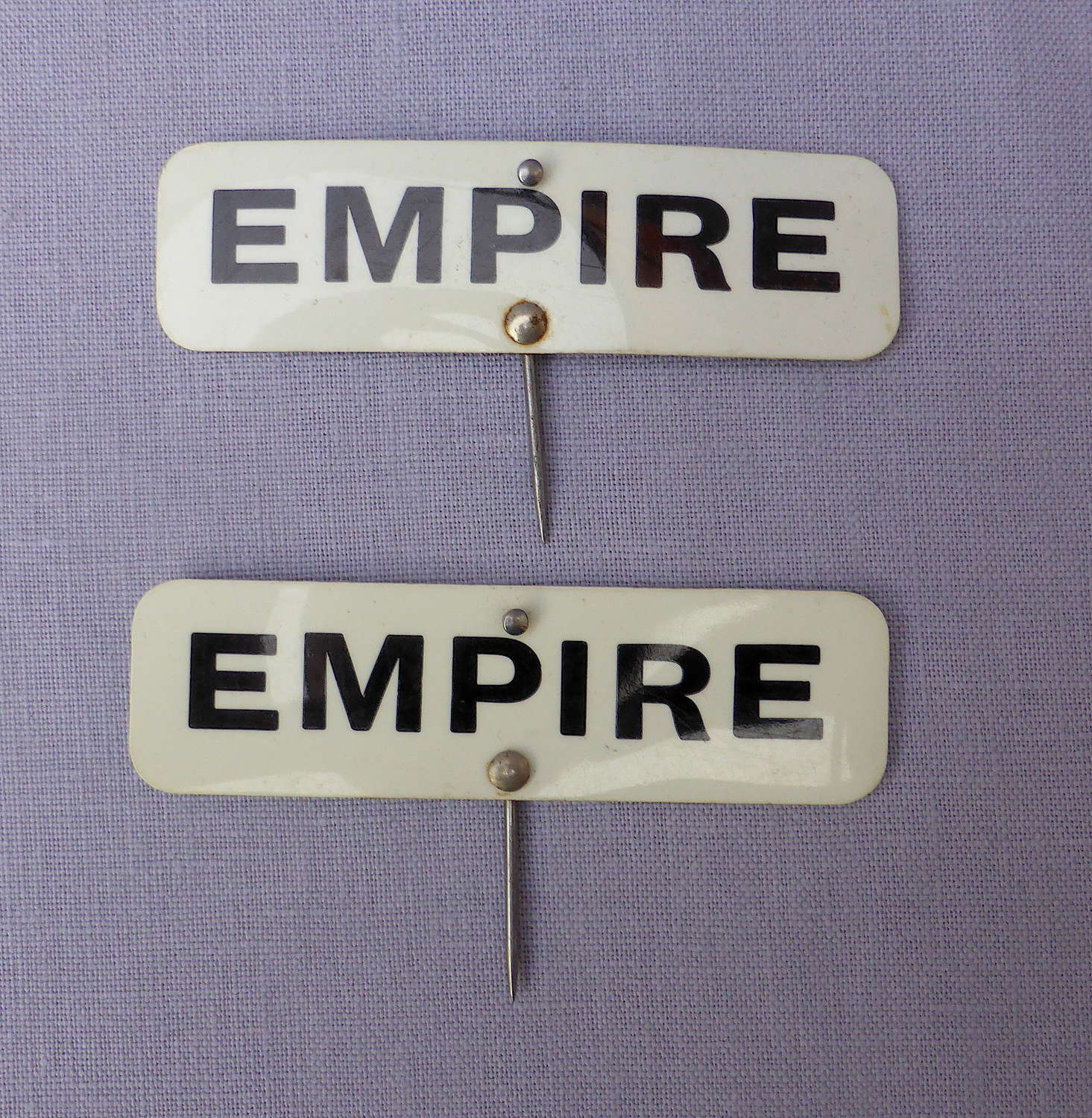 Pair of celluloid Empire grocery shop labels